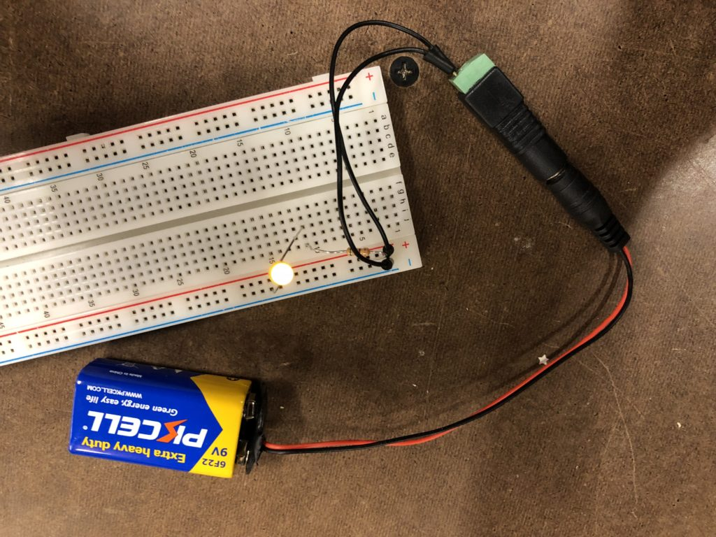 Breadboard with lit LED