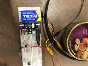 9-volt battery and power supply chip powering a breadboard with two buttons