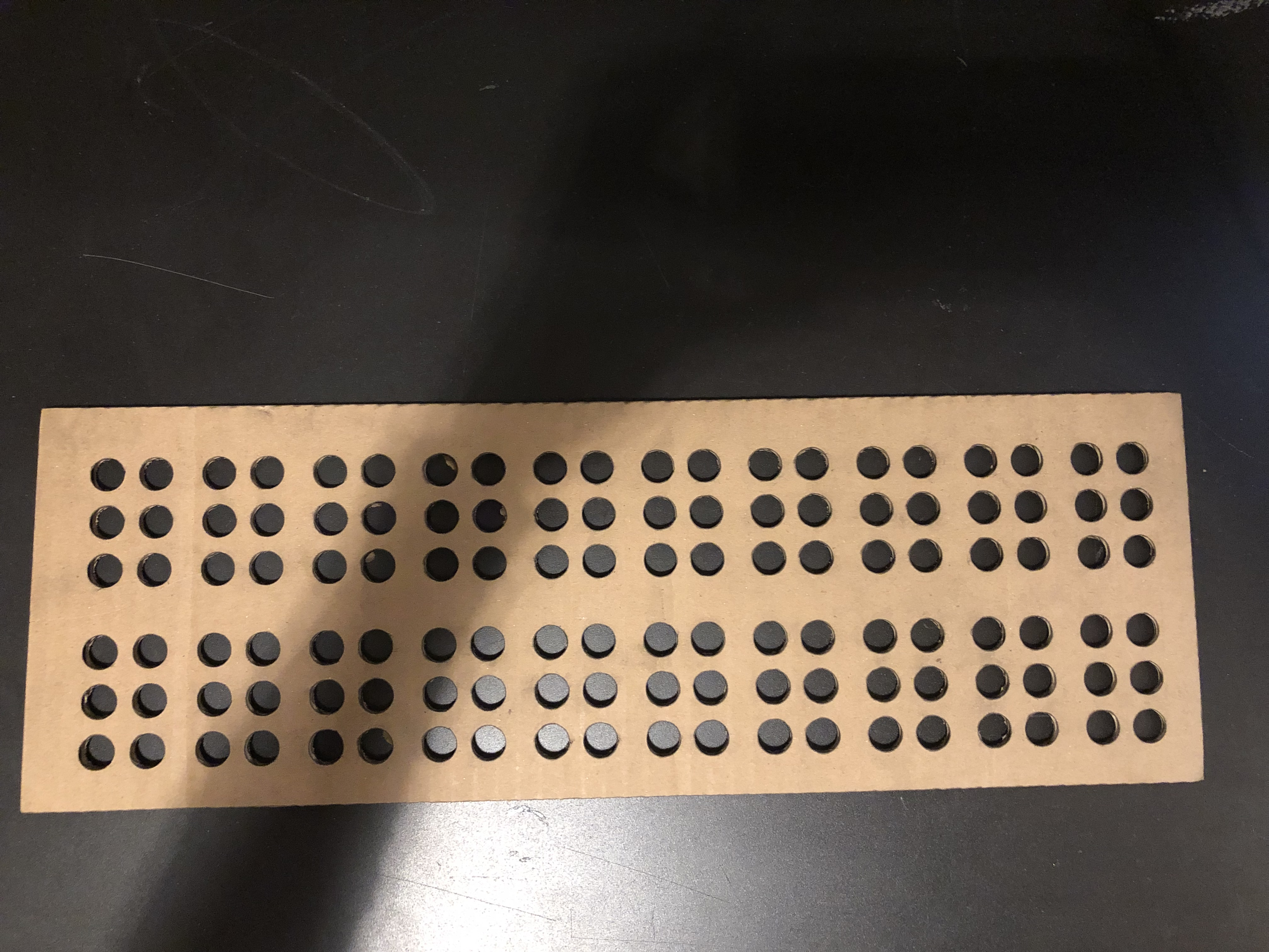 card board braille peg board.