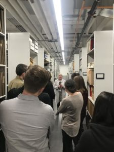 Students listening to archivist at FIT archives