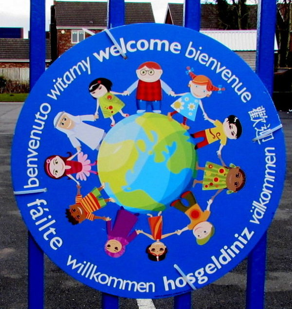 picture of earth with cartoon children around it and the word welcome in several languages
