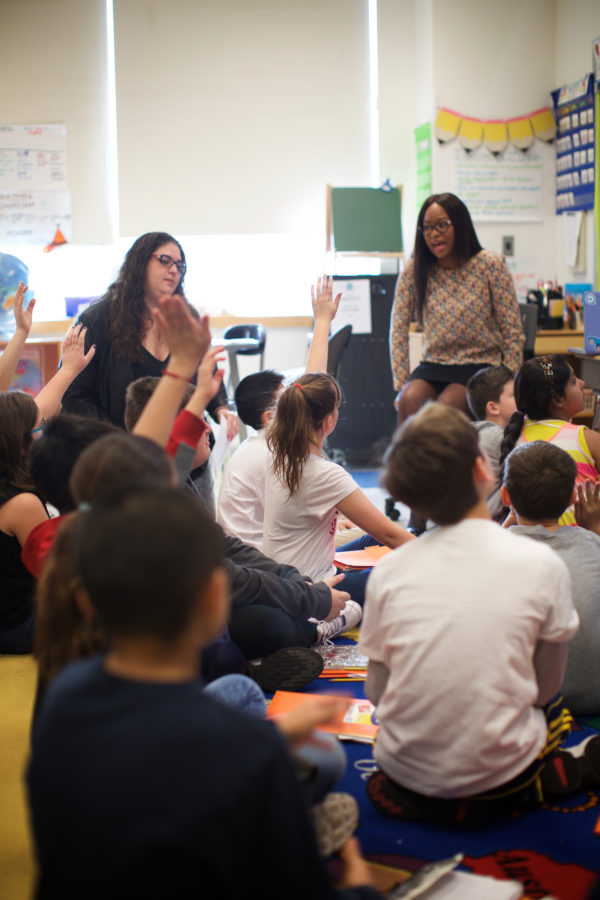 an elementary classroom with two teachers, one a Caucasian woman, one an African American woman