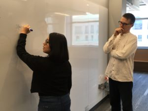 Mendoza and Lostanlen working at the whiteboard