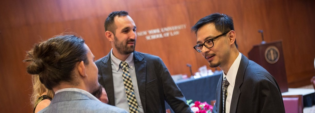 S. Matthew Liao talking with a group of people at a book launch event