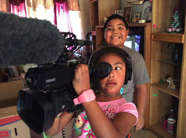 Two girls with camera from Tribal Justice documentary