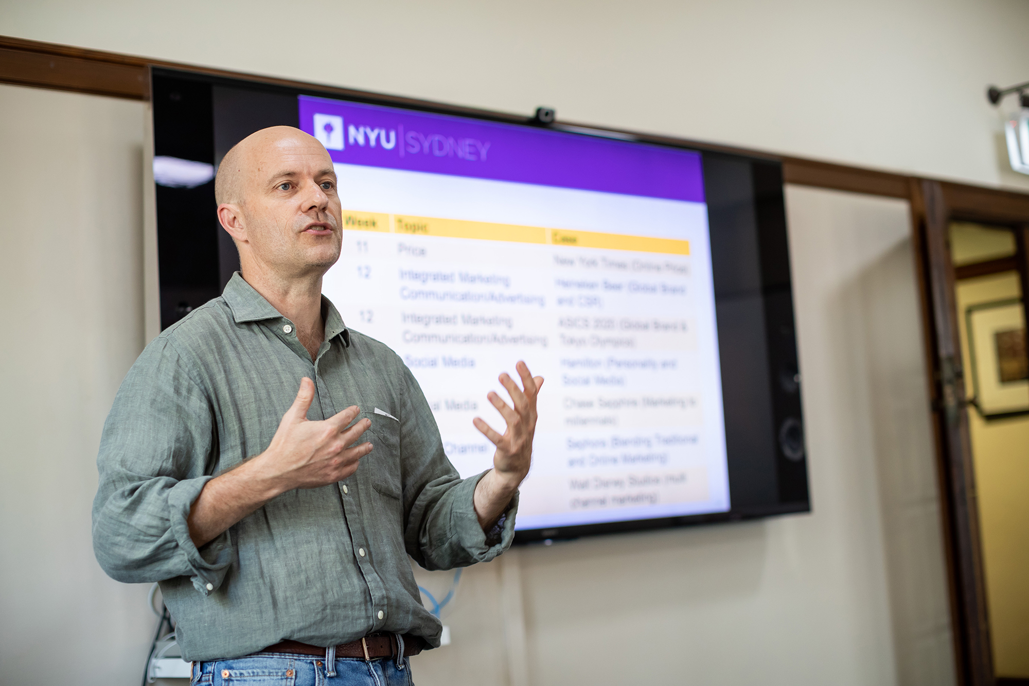 Professor Andy West leads a marketing course at NYU Sydney