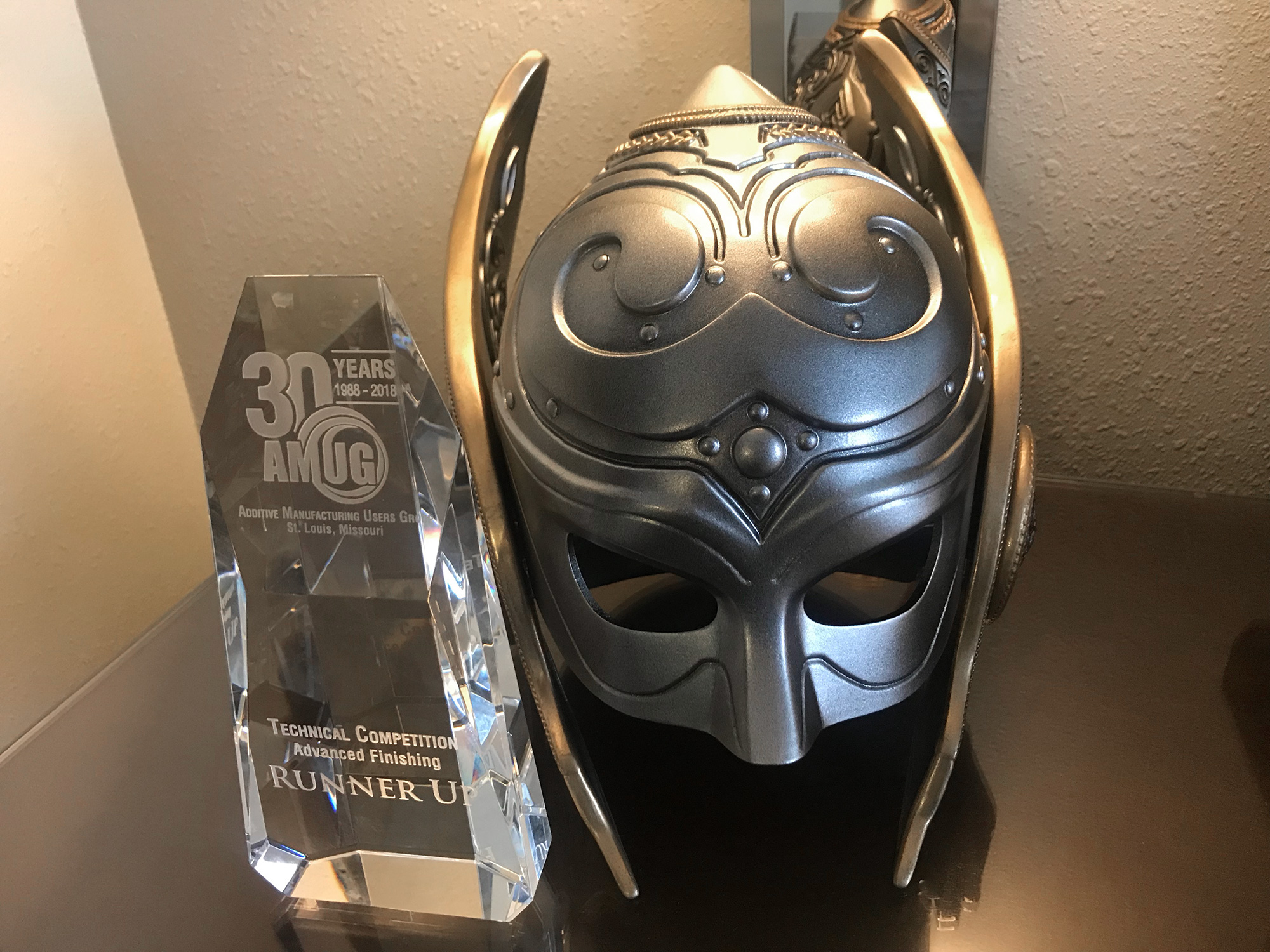 Jane Foster's helmet next to the AMUGS award