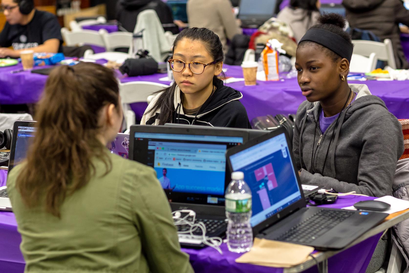 Students conversing during hackathon