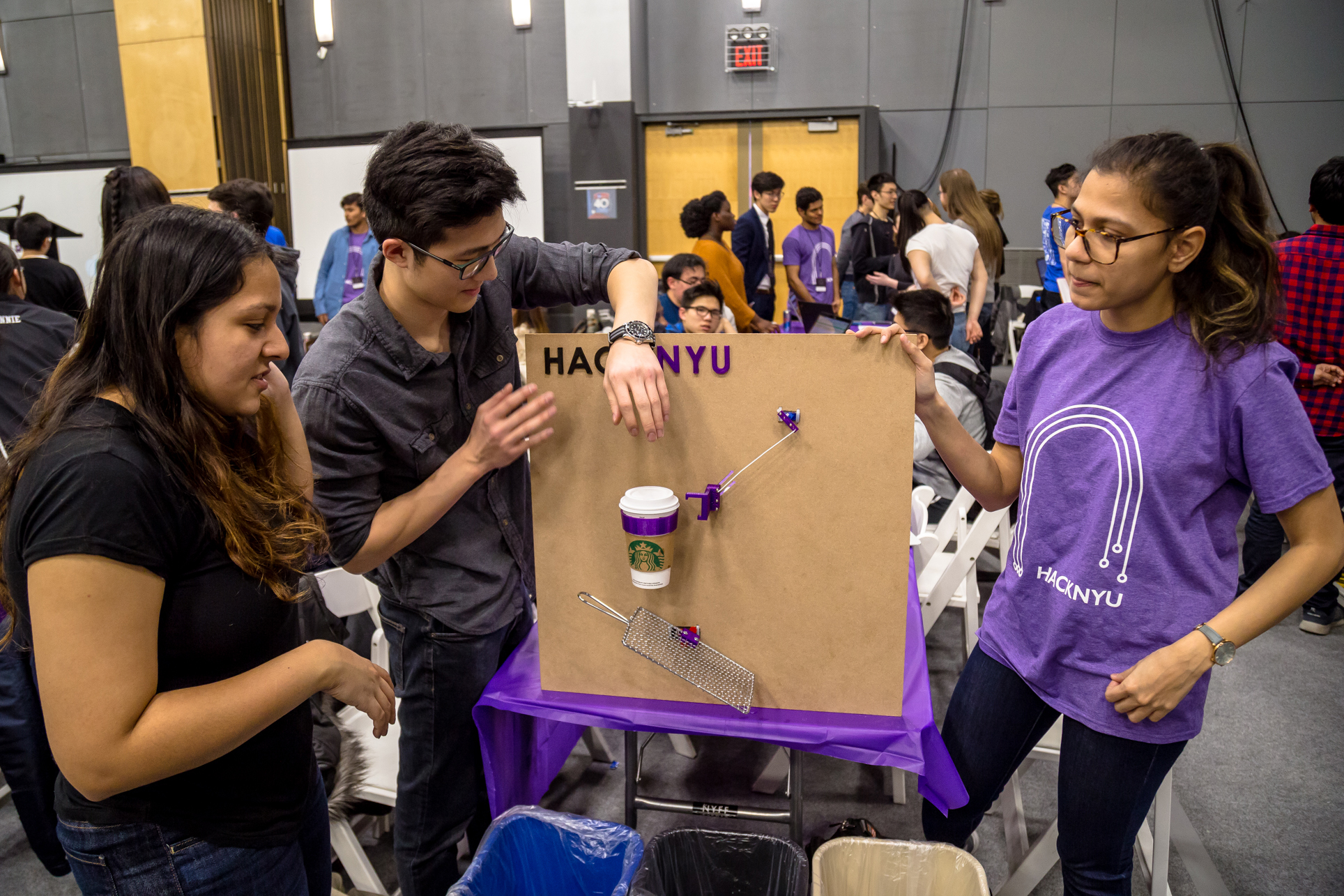 Students exhibiting their HackNYU project