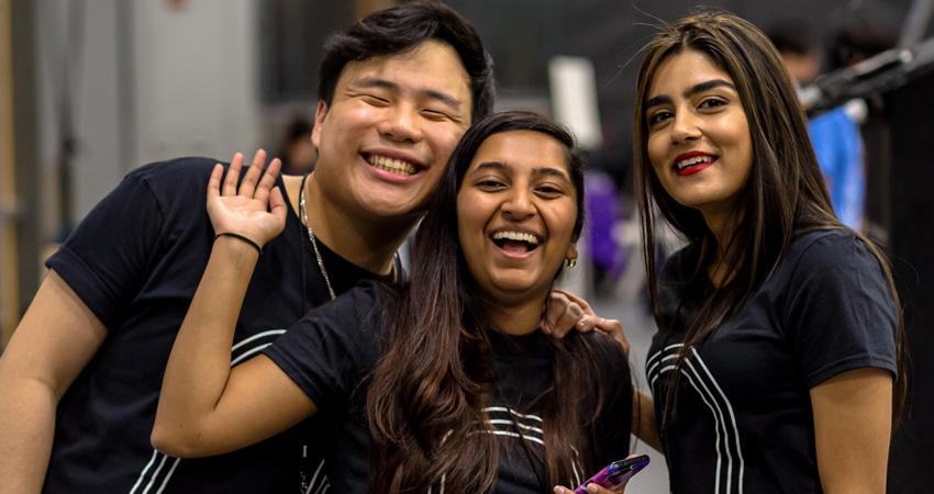 HackNYU co-chairs Eric Kwok and Chandrika Khanduri with next year's co-chair, Srishti Sanya