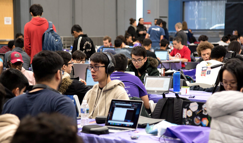 Large crown of HackNYU participants working at their computers