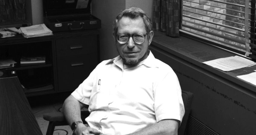 George Sadowsky sitting behind a desk in an office
