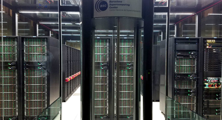 glass revolving door leading to a chamber containing racks of computer servers
