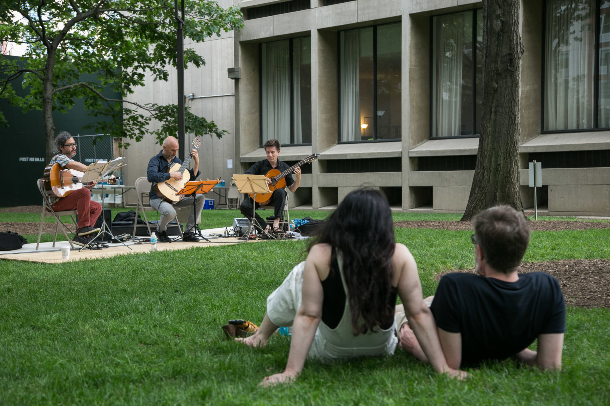 People listening to music on lawn