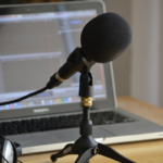 microphone and laptop stock photo