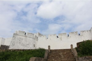 white fort against cloudy sky