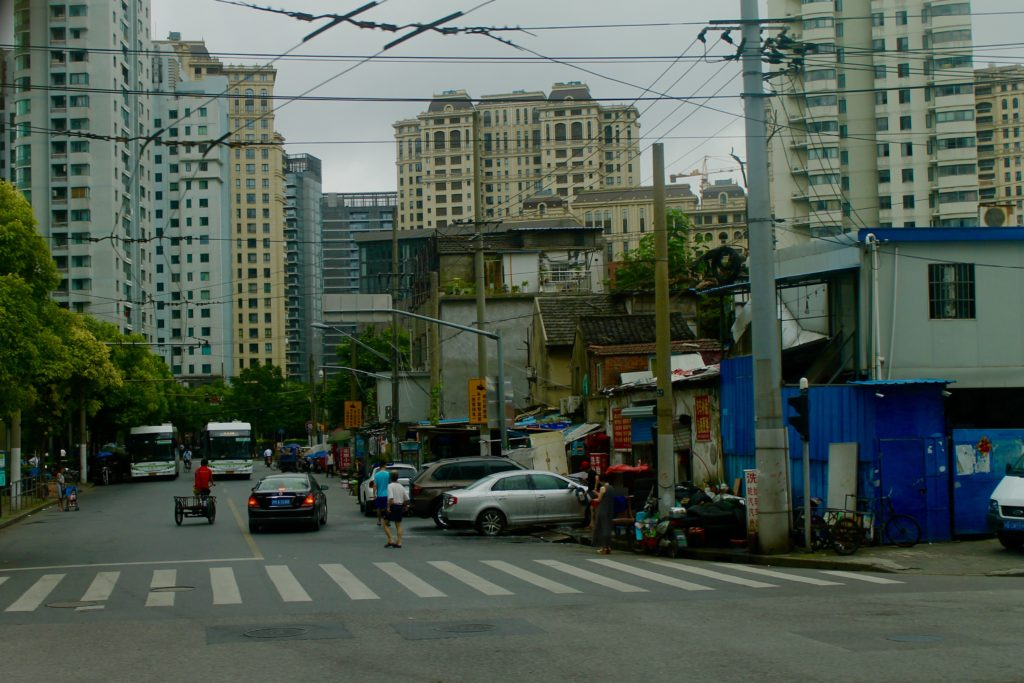 Shanghai's oldest neighborhood, older tall buildings in the distance.