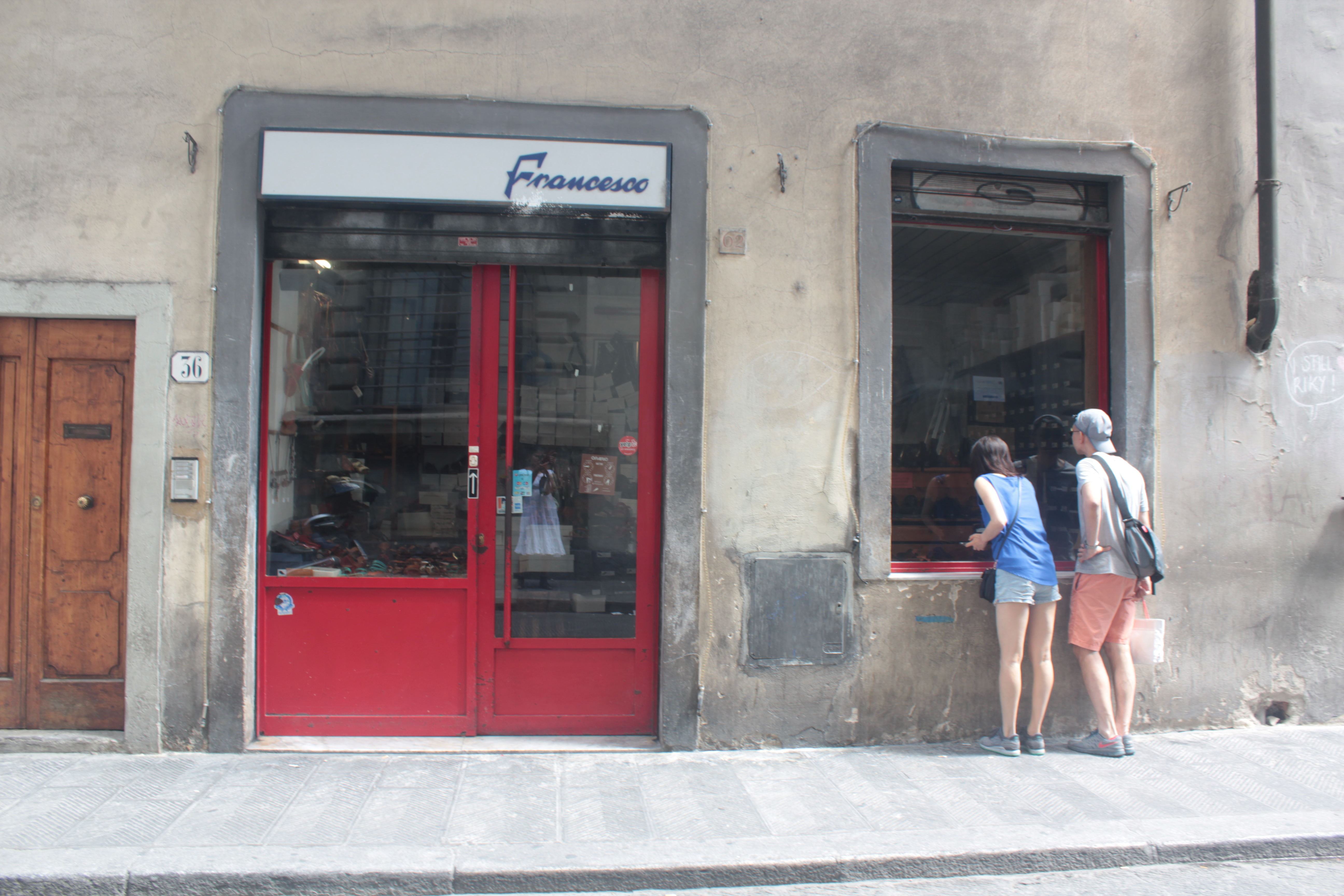 people looking into shop window