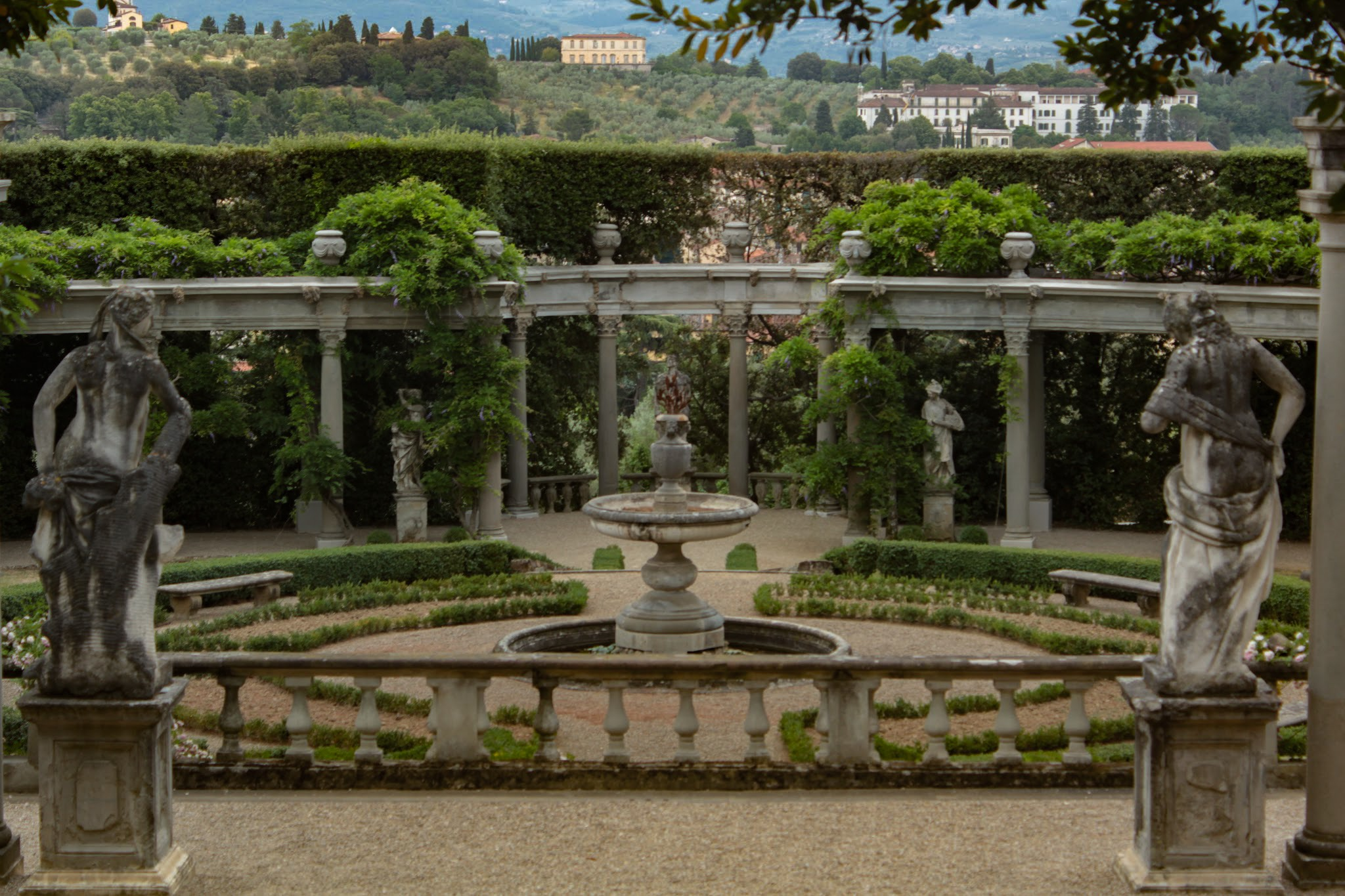 garden with fountain and statues