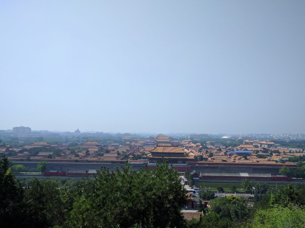 The golden roofs of the Forbidden City on the smoggy backdrop of Beijing