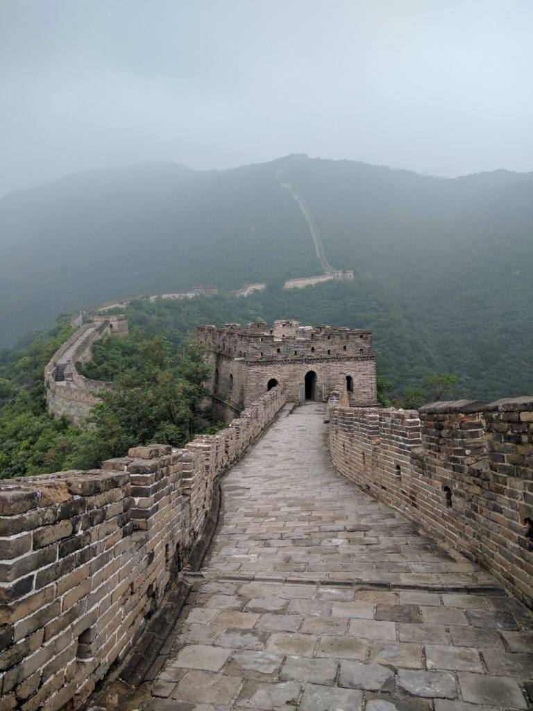 The Great Wall of China stretching up and over a mountain