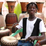 man drumming with stick