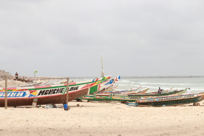 many colorful fishing canoes on beach