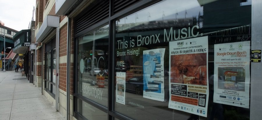"Building windows that read ""This is Bronx Music."""