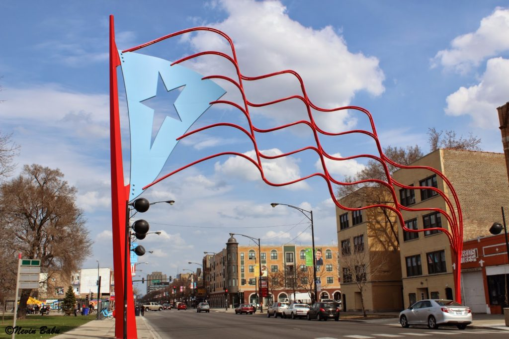 Sculpture of a Puerto Rican flag outside.