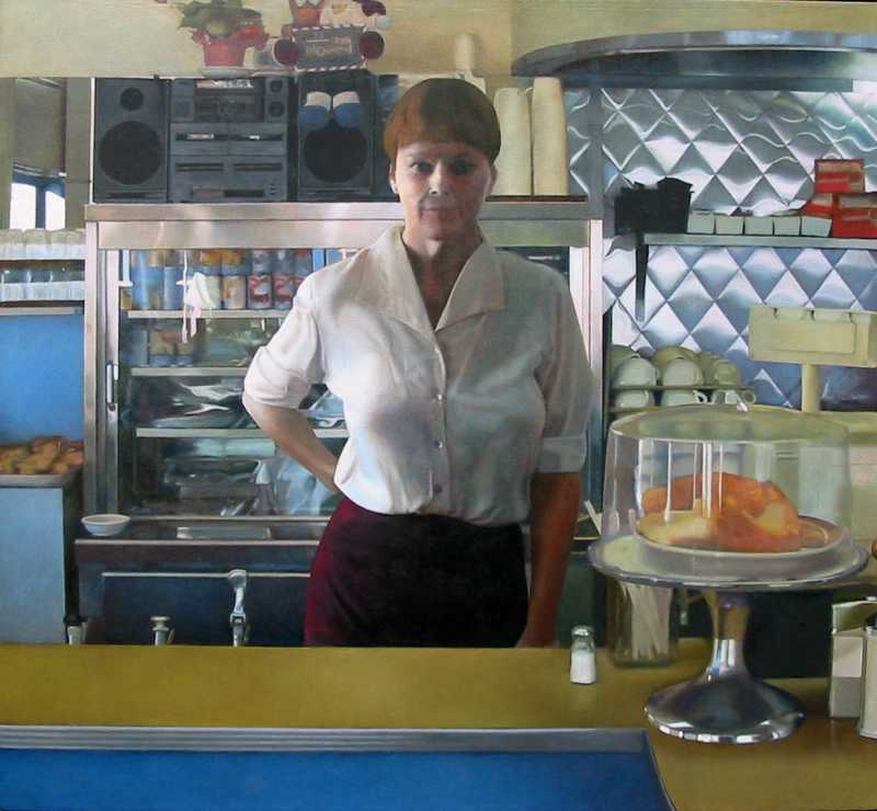 A woman in a white blouse and red skirt standing at the counter of a deli