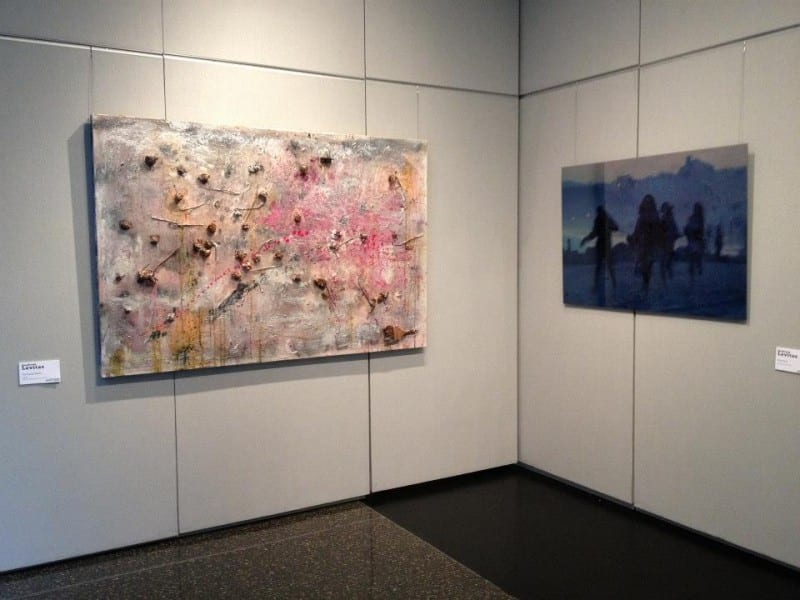 The preceding abstract painting next to a painting in blue