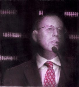 Overexposed print of white man in suit talking.