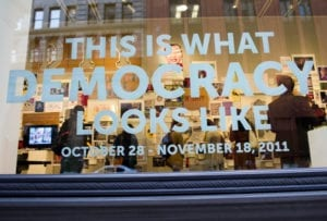 """Gallery Street Window with the text """"This is What Democracy Looks Like October 28-November 18, 2011"""""""