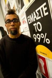 Portrait of Artist Dread Scott in gallery space