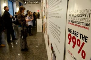 People analyze the artwork while in gallery space