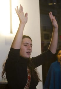 Action shot of woman performing gallery space
