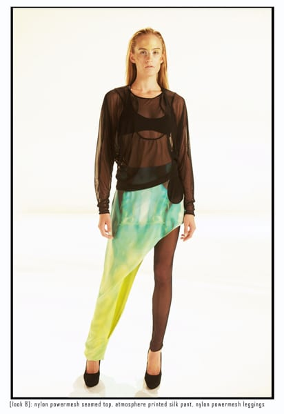 A model dressed in a sheer shirt and neon green one legged pants with sheer leggings on the other leg.