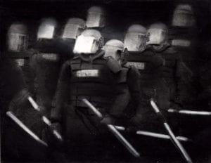 Black & white image of swat team