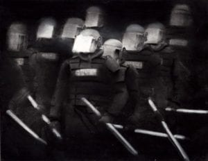 black and white lo-fi image of swat team