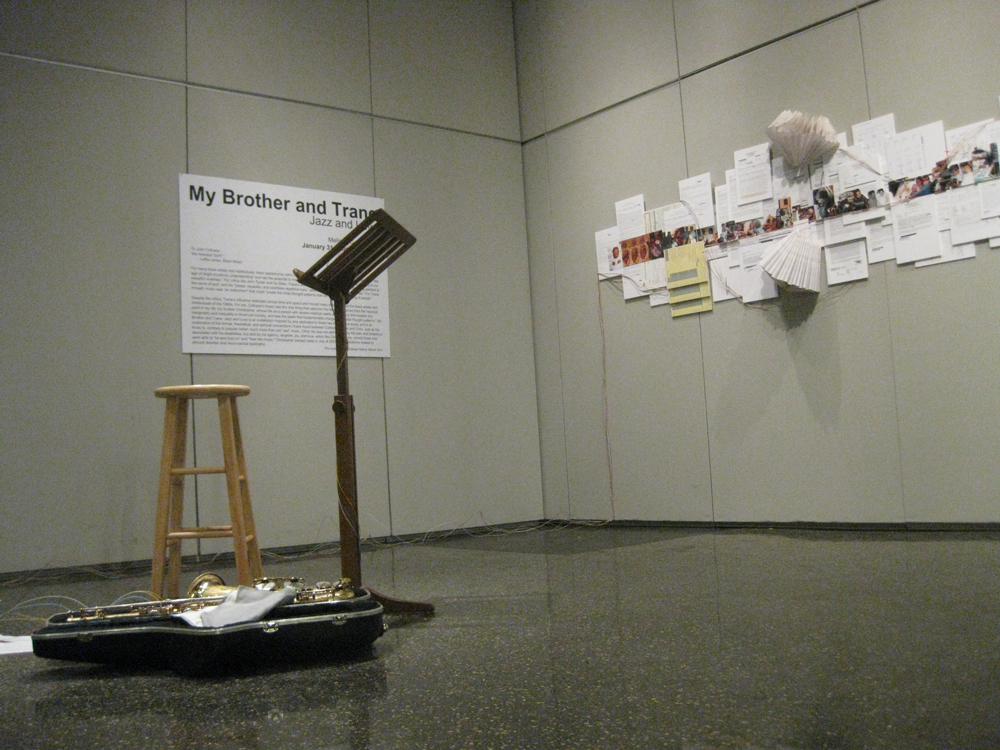 a wide shot of the entire exhibit: the wall, the pedestal and the stool and the poster