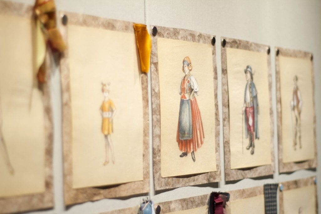 Gallery Wall: various fabric prints with women as subjects are depicted.