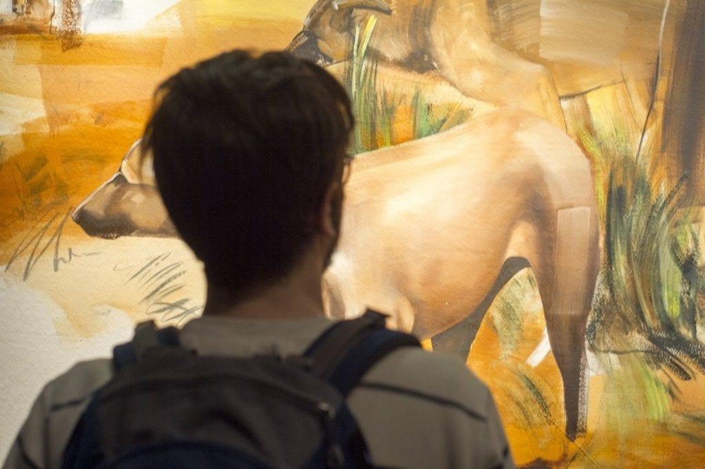 Man viewing artwork in gallery space