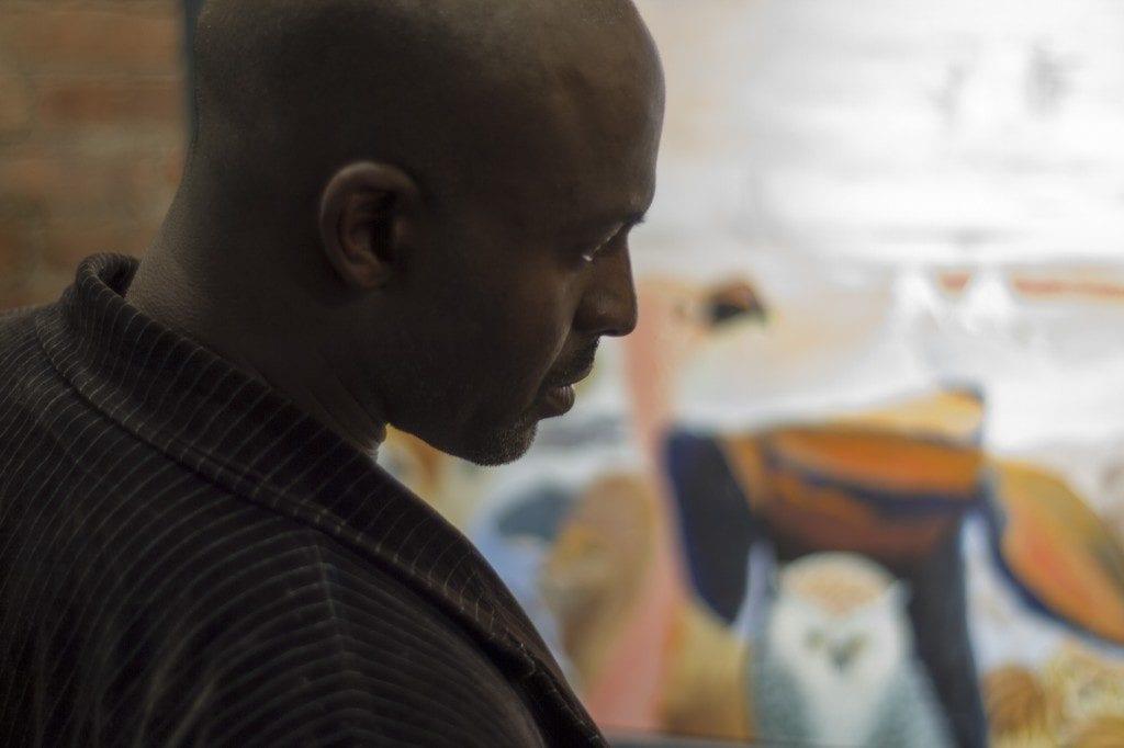 Man viewing art work in gallery space