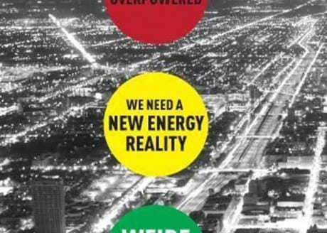 "Black & white vintage cityscape with text in yellow circle stating ""We need a new energy reality"""