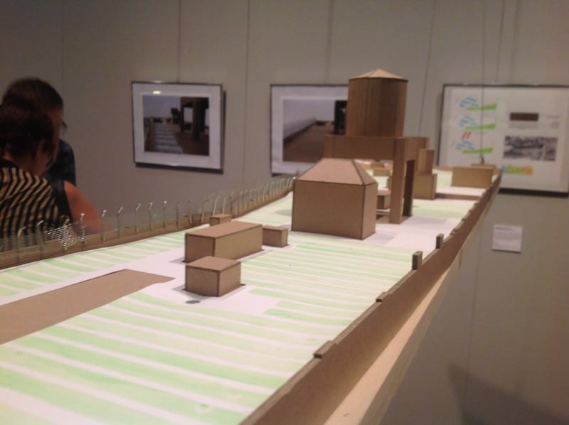boxes piled up and laid besides each other to form a model