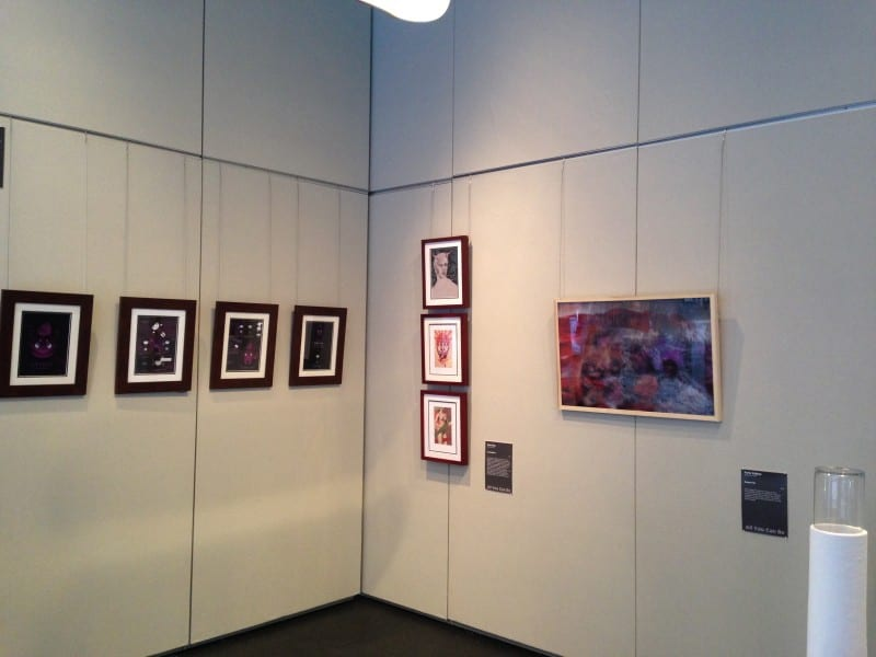 Gallery walls with artwork displayed.