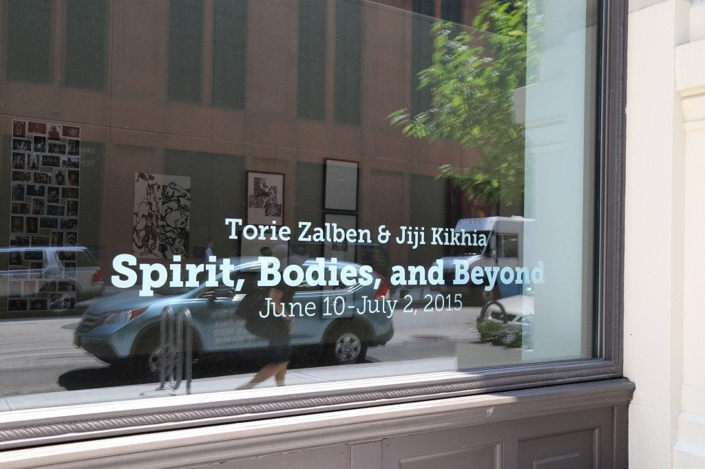 """Spirit Bodies and Beyond"" vinyl as seen through the Gallery window"