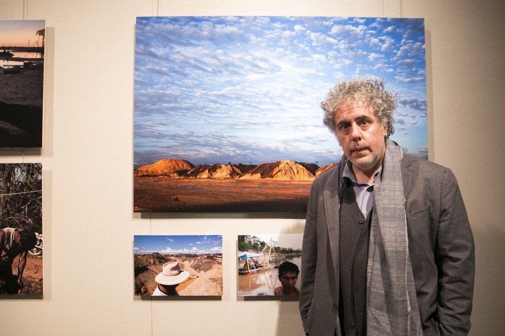 Ron Haviv in front of art work