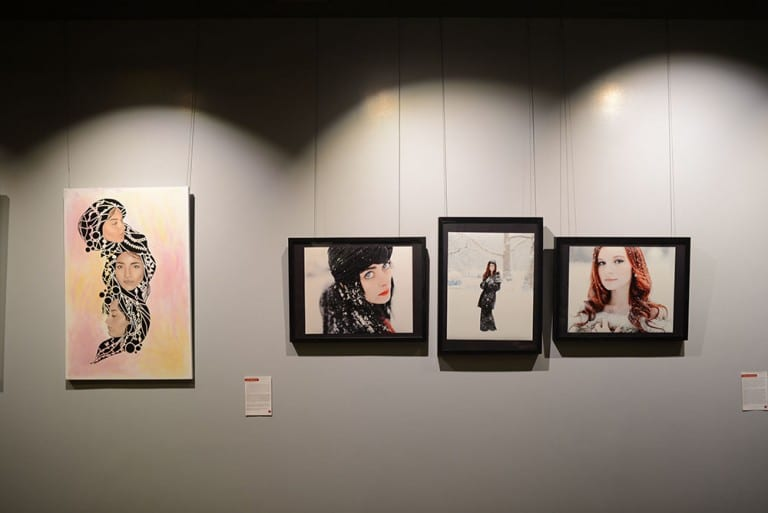 Gallery Wall: Four artworks displayed with female subjects.