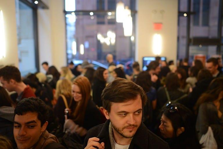 Multiple people in gallery space viewing artwork